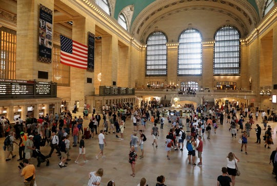 Visitors and commuters mill around the main concourse at Grand Central Terminal in New York, Aug. 9, 2018.