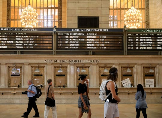 The Grand Central Terminal flip boards are pictured in the main concourse, Aug. 9, 2018. They are actually one minute off, meant to give commuters an extra few seconds to catch their train.