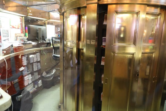 The brass structure inside the information booth, at Grand Central Terminal has sliding doors on it. Those open up to reveal a secret connecting staircase between the upper and lower information booths.