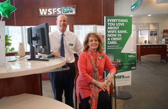 WSFS CEO Rodger Levenson and Peggy Eddens, executive vice president and chief associate and customer experience officer, stand in the lobby of WSFS bank branch in downtown Wilmington in 2018. WSFS bank was voted 1st place for Top Workplace for a large company.