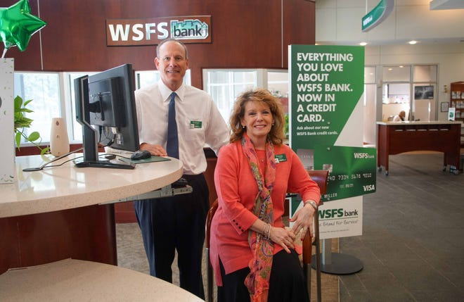 Soon-to-be WSFS CEO Rodger Levenson and Peggy Eddens, executive vice president and chief associate and customer experience officer, stand in the lobby of WSFS bank branch in downtown Wilmington. WSFS bank was voted 2nd for Top Workplace for a large company.