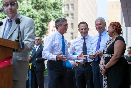 Gov. John Carney (from left) Rob Buccini, Mayor Mike Purzycki, and Council President Hanifa Shabazz mingle during the Grand Opening Celebration & Ribbon Cutting Ceremony in downtown Wilmington of the Residences at Mid-town Park.