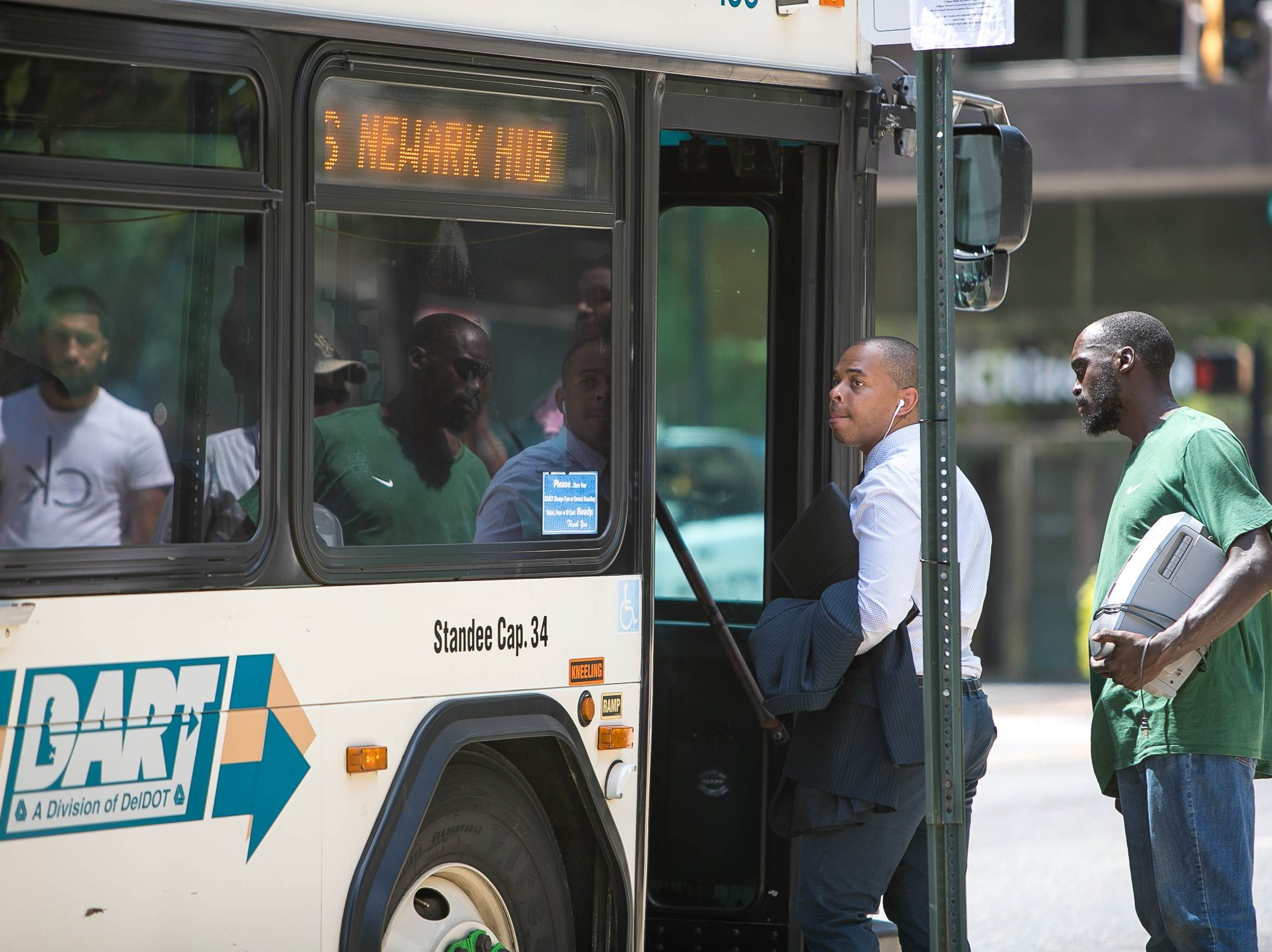 Riders get on DART bus 6 which was brought back to Rodney Square.