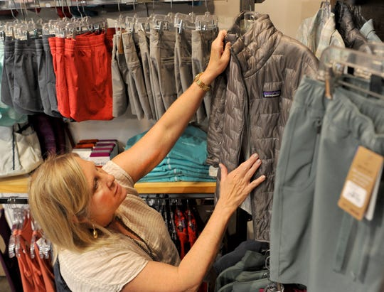 Annie Jewel & Charlie's owner Debbie Bigot arranges her store's inventory in preparation for the tax-free weekend Thursday. The tax-free weekend begins on Aug. 10 and ends on Aug. 12,  according to the Texas Comptroller website.