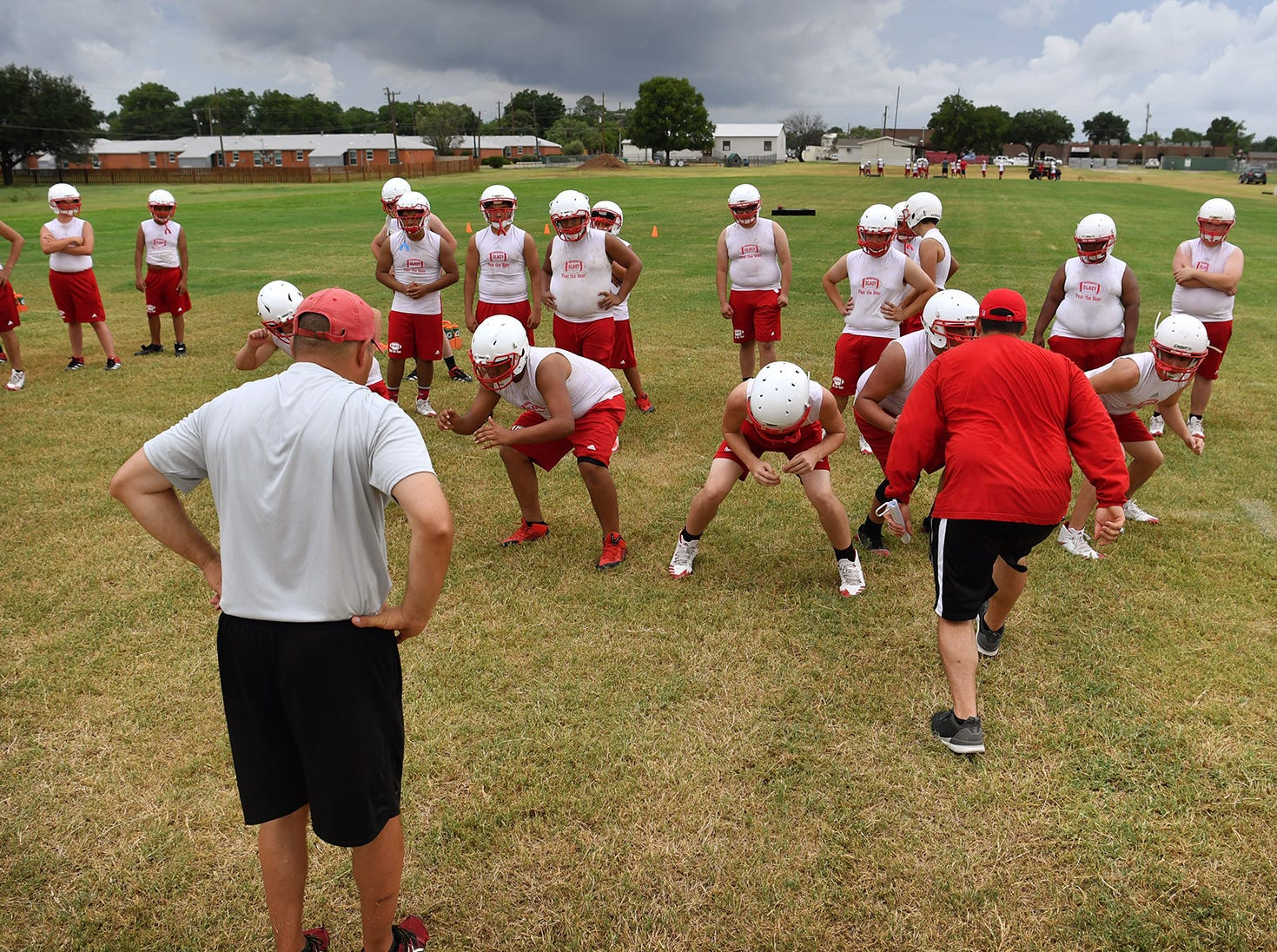Olney Cubs linemen work on formations and footwork during practice.