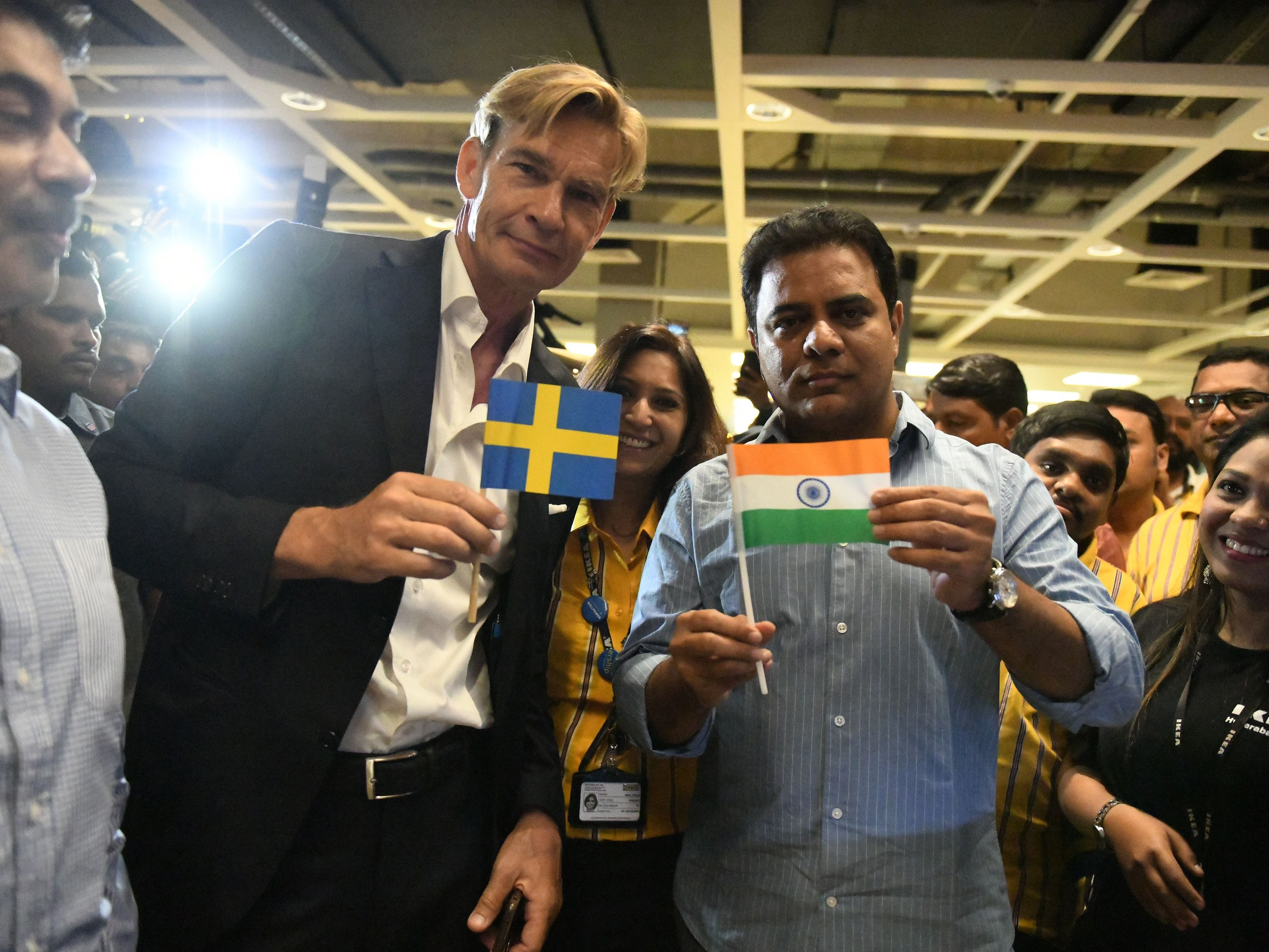 Ambassador of Sweden, Mr Klas Molin, left, with K. Taraka Rama Rao, State Minister of Telangana holds flags of India and Sweden during the opening ceremony of the new IKEA store in Hyderabad on Aug. 9, 2018. Curious customers lay on beds and nestled into armchairs on Aug. 9 as Ikea opened its first Indian outlet, hoping to wow a burgeoning middle class with offerings tweaked to local tastes, including its famous meatballs.