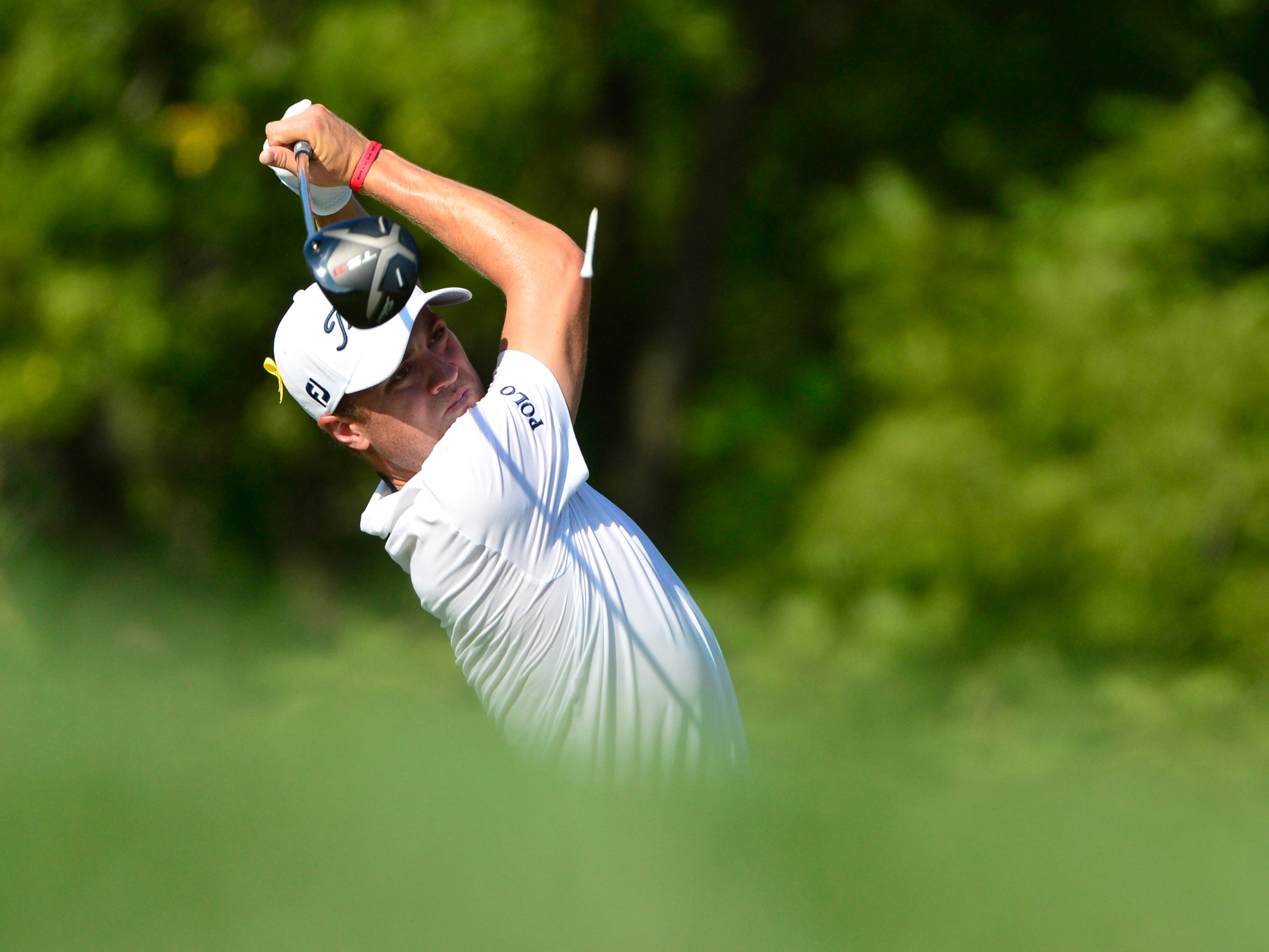 Justin Thomas hits his tee shot on the 12th hole during the first round of the PGA Championship.