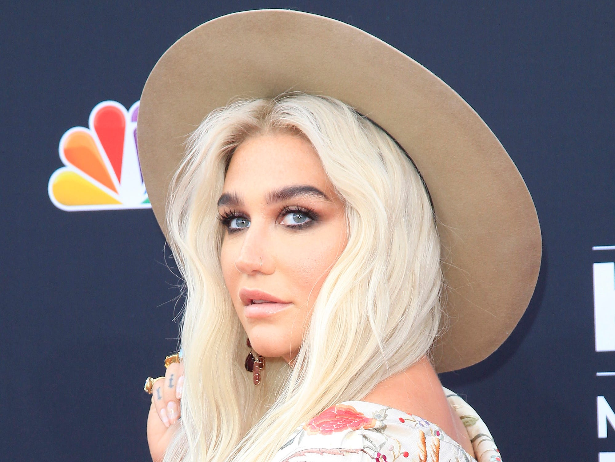 Kesha is a pop music survivor, evolving from the hard-partying image of her early years into a suited-up rock star, with her 2017 album 'Rainbow' marking her triumphant return to music. Revisit Kesha's Kesha's career in photos, with the star seen here arriving to the 2018 Billboard Music Awards in Las Vegas, Nevada, on May 20, 2018.