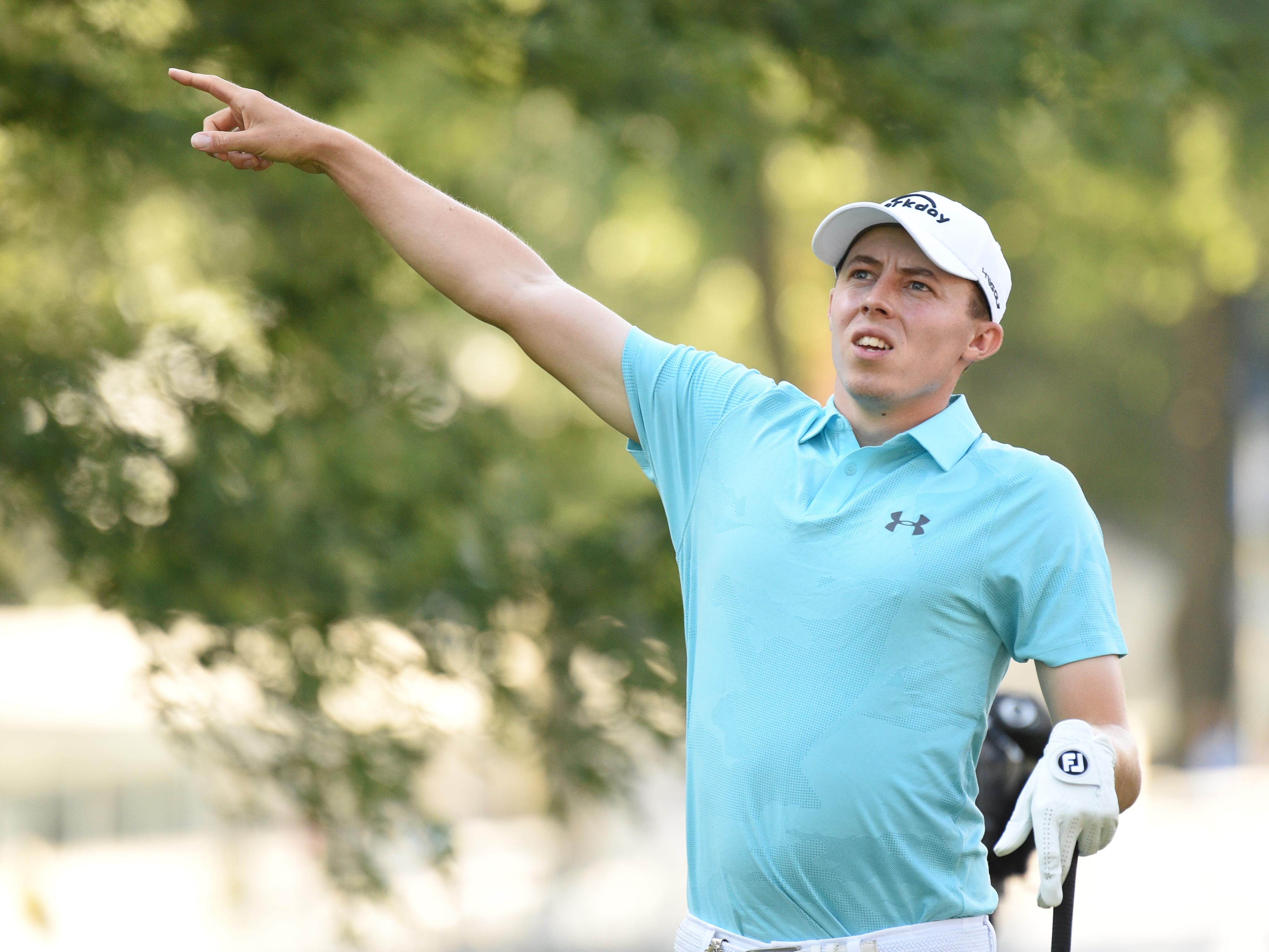 Matthew Fitzpatrick reacts after hitting his tee shot on the 11th hole during the first round.