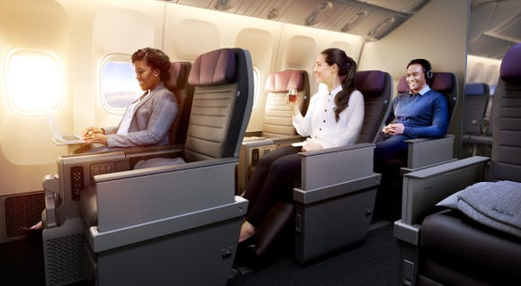 This image provided by United shows purple hues on its new international-style premium economy seats.