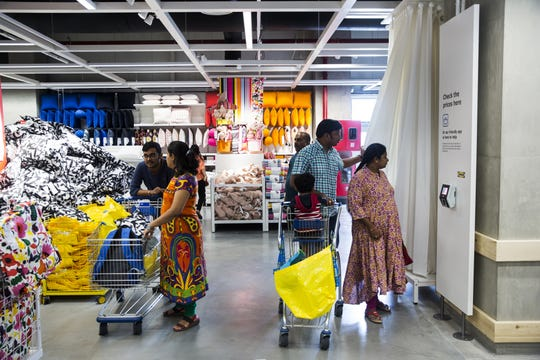 Customers walk past cushions on display inside the Ikea store in Hitech City on the outskirts of Hyderabad, India, on Thursday, Aug. 9, 2018. Ikea's blue-and-yellow stores are instantly recognizable: iconic, monolithic and now, as India's first store throws open its doors to the masses today, operating in more than 400 stores in some 50 countries. Photographer: Udit Kulshrestha/Bloomberg via Getty Images