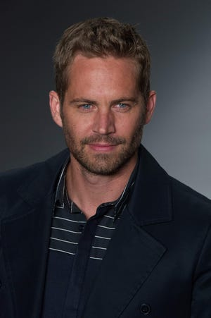 (FILES) This file photo taken on March 21, 2013 shows American actor Paul Walker wearing a creation by Colcci during the 2013 Summer collections of the Sao Paulo Fashion Week in Sao Paulo, Brazil. A Los Angeles court on April 5, 2016 found German auto maker Porsche, not resposible in the 2013 accident which killed the actor. / AFP PHOTO / YASUYOSHI CHIBAYASUYOSHI CHIBA/AFP/Getty Images ORG XMIT: Death of ORIG FILE ID: 550656998
