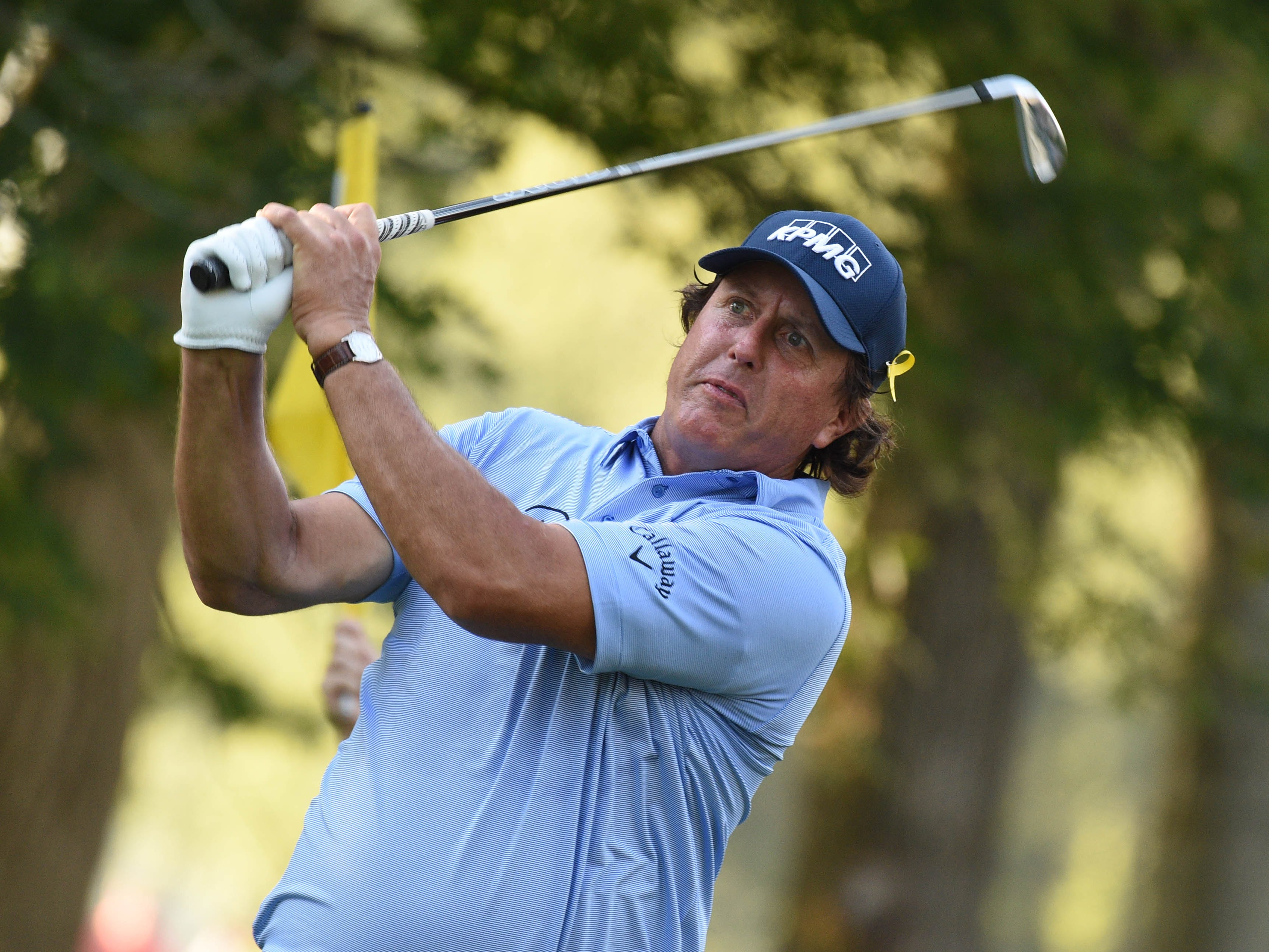Phil Mickelson hits his tee shot on the 10th hole during the first round of the PGA Championship.