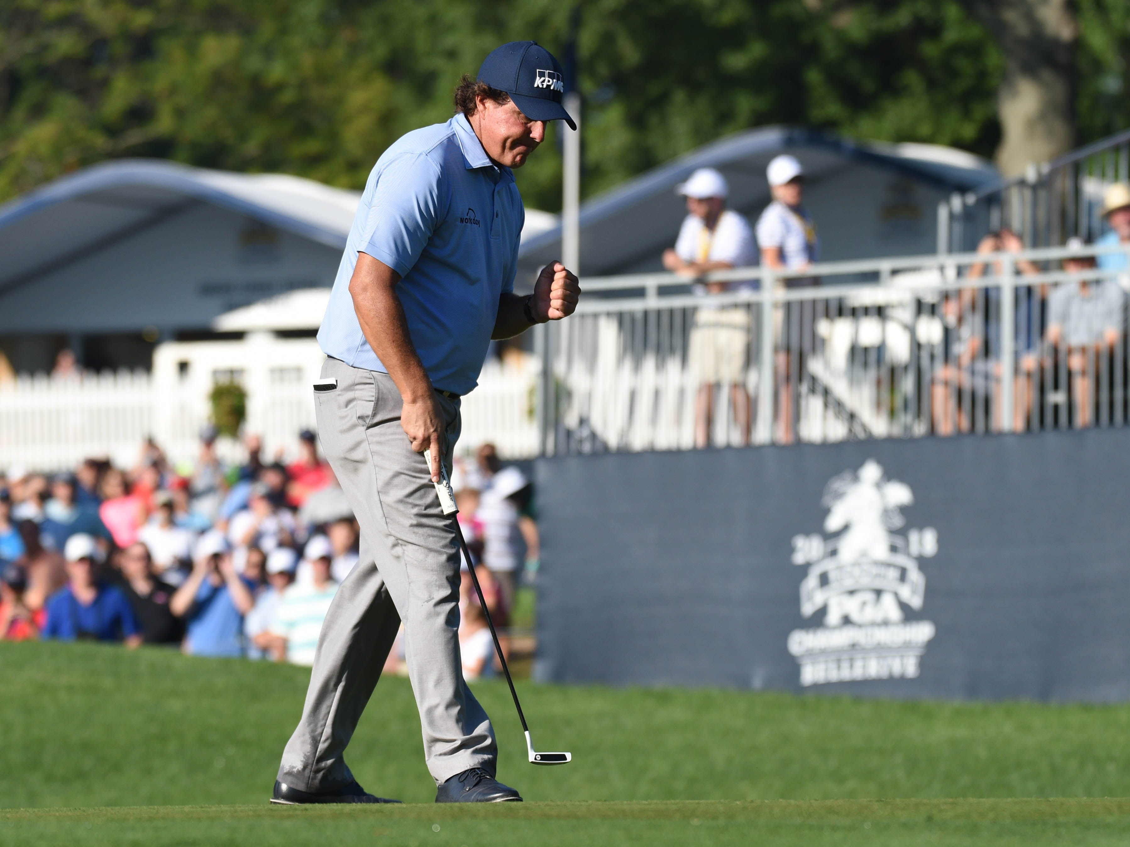 Phil Mickelson reacts after putting on the 10th green during the first round.