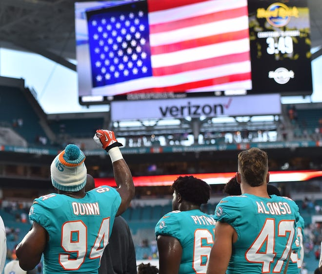 Dolphins defensive end Robert Quinn raised his fist during the national anthem on Thursday.