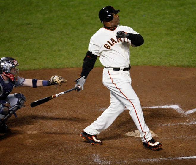Barry Bonds hits home run No. 756, breaking Hank Aaron's all-time career home run record on Aug. 7, 2007, at AT&T Park in San Francisco.