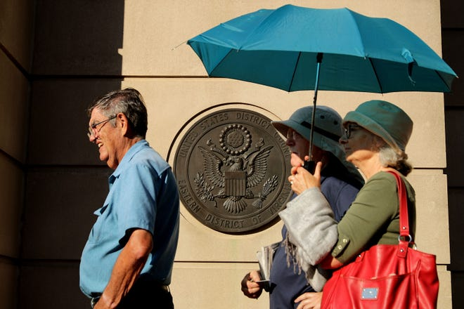 People line up outside the Albert V. Bryan U.S. Courthouse on the seventh day of former Trump campaign chairman Paul Manafort's trial Aug. 8, 2018 in Alexandria, Virginia.