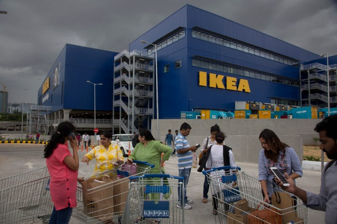 Customers stand outside IKEA's first store in India as it opened in Hyderabad, India, Thursday, Aug.9, 2018. Swedish home furnishings giant IKEA opened its first store in India on Thursday, five years after it received approval to invest in the country's single-brand retail sector.