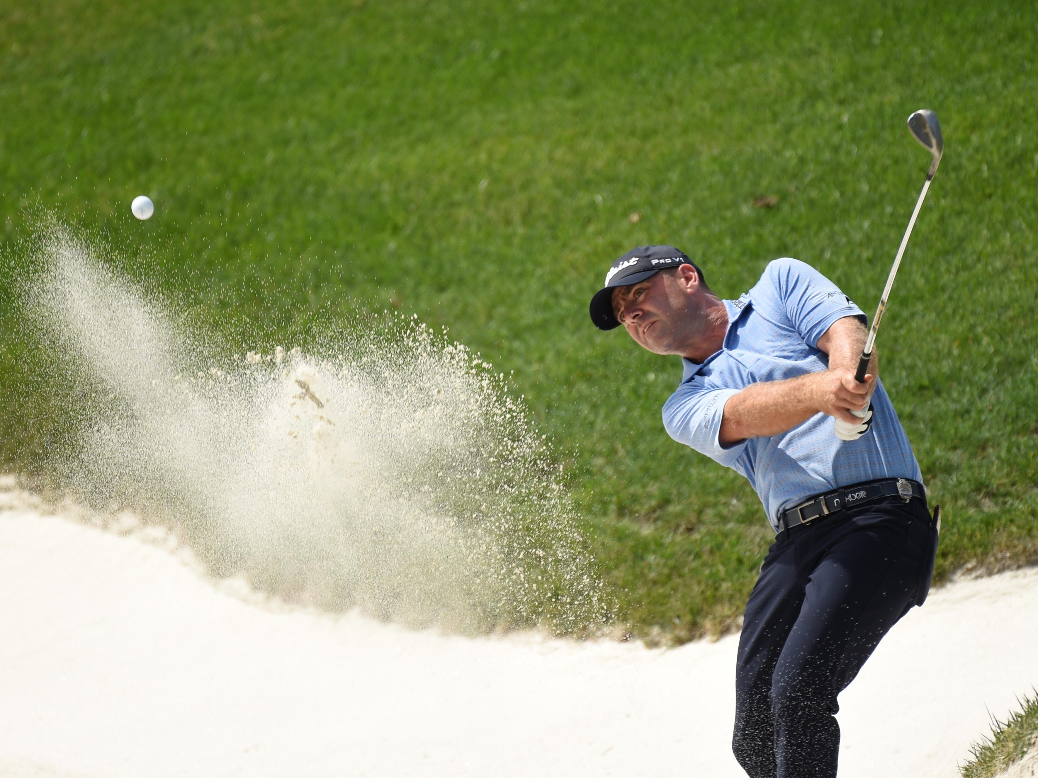 Ryan Armour hits out of a bunker on the 10th hole during the first round.