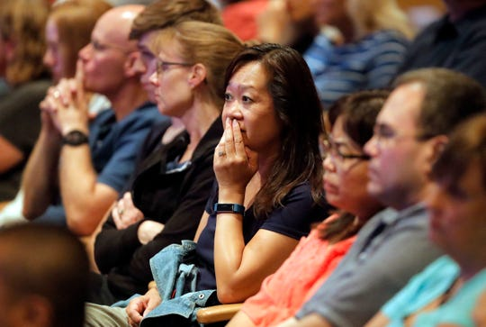 Audience members react as it was announced on Wednesday, Aug. 8, 2018, at Willow Creek Community Church in South Barrington, Illinois, that lead pastor Heather Larson is stepping down along with the church's board.