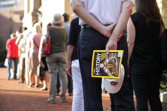People who say they find the trial part entertainment, part curiosity, line up outside the Albert V. Bryan U.S. Courthouse on the seventh day of former Trump campaign chairman Paul Manafort's trial Aug. 8, 2018 in Alexandria, Virginia.