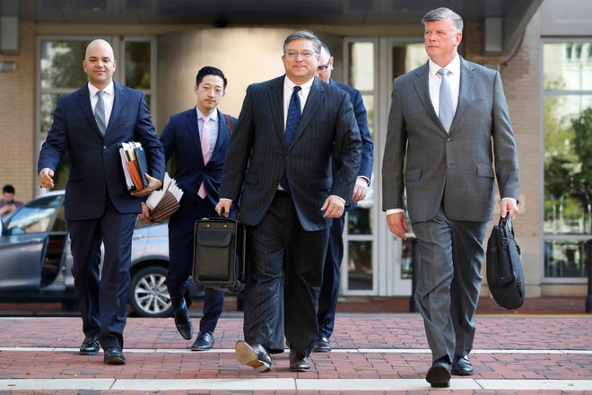 The defense team for Paul Manafort, including Kevin Downing, right, and Jay Nanavati, far left, walks to federal court as the trial of the former Trump campaign chairman continues, in Alexandria, Va., Aug. 9, 2018.