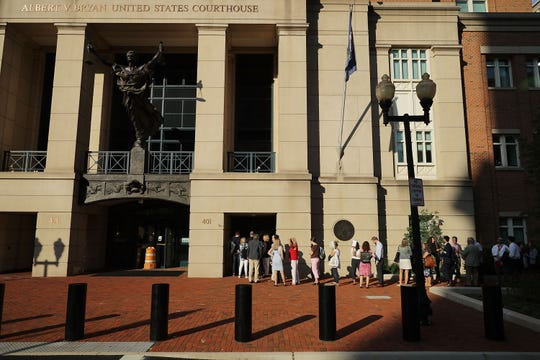 People line up outside the Albert V. Bryan U.S. Courthouse on the seventh day of former Trump campaign chairman Paul Manafort's trial Aug. 8, 2018, in Alexandria, Virginia.