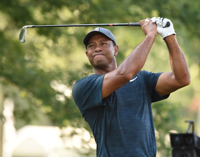 Tiger Woods hits his tee shot on the 11th hole during the first round of the PGA Championship at Bellerive Country Club.