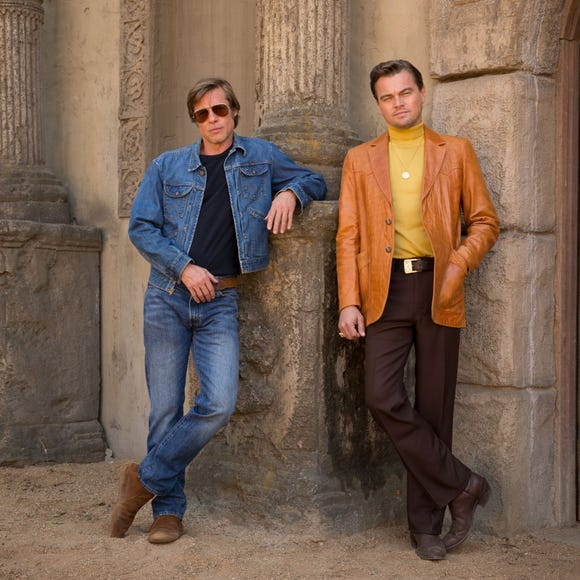 "Brad Pitt and Leonardo DiCaprio are seen in all their 1970s glory in the first set photo from Quentin Tarantino's Manson murders movie ""Once Upon a Time in Hollywood."""