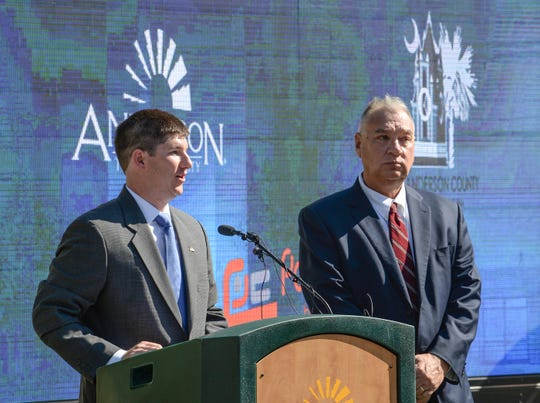 David McCuen, left, Assistant City Manager, and Rusty Burns, right, Anderson County Administrator announce plans for a $12 million development with a hotel in downtown Anderson were unveiled on Friday, August 10.