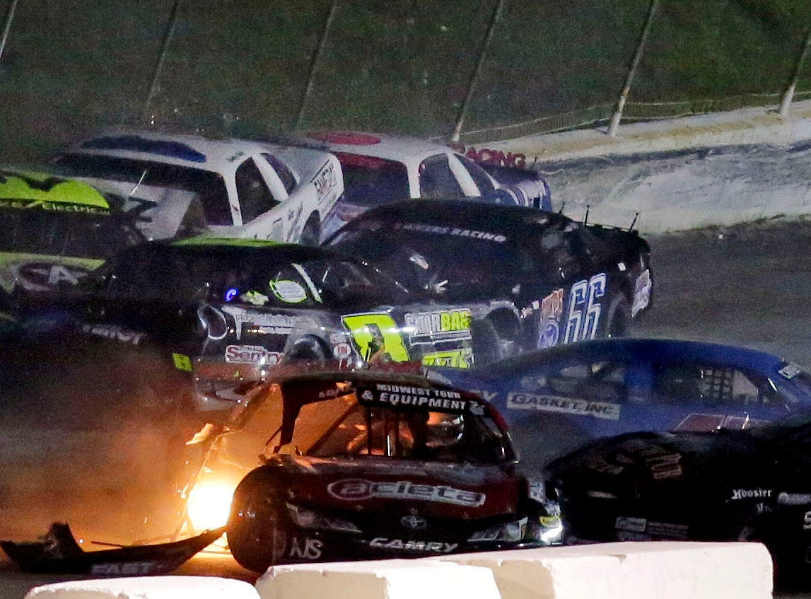 "Cars are damaged as the Red, White and Blue series concludes with the ""Blue Race"" Thursday, August 9, 2018, at Wisconsin International Raceway in Kaukauna, Wis.