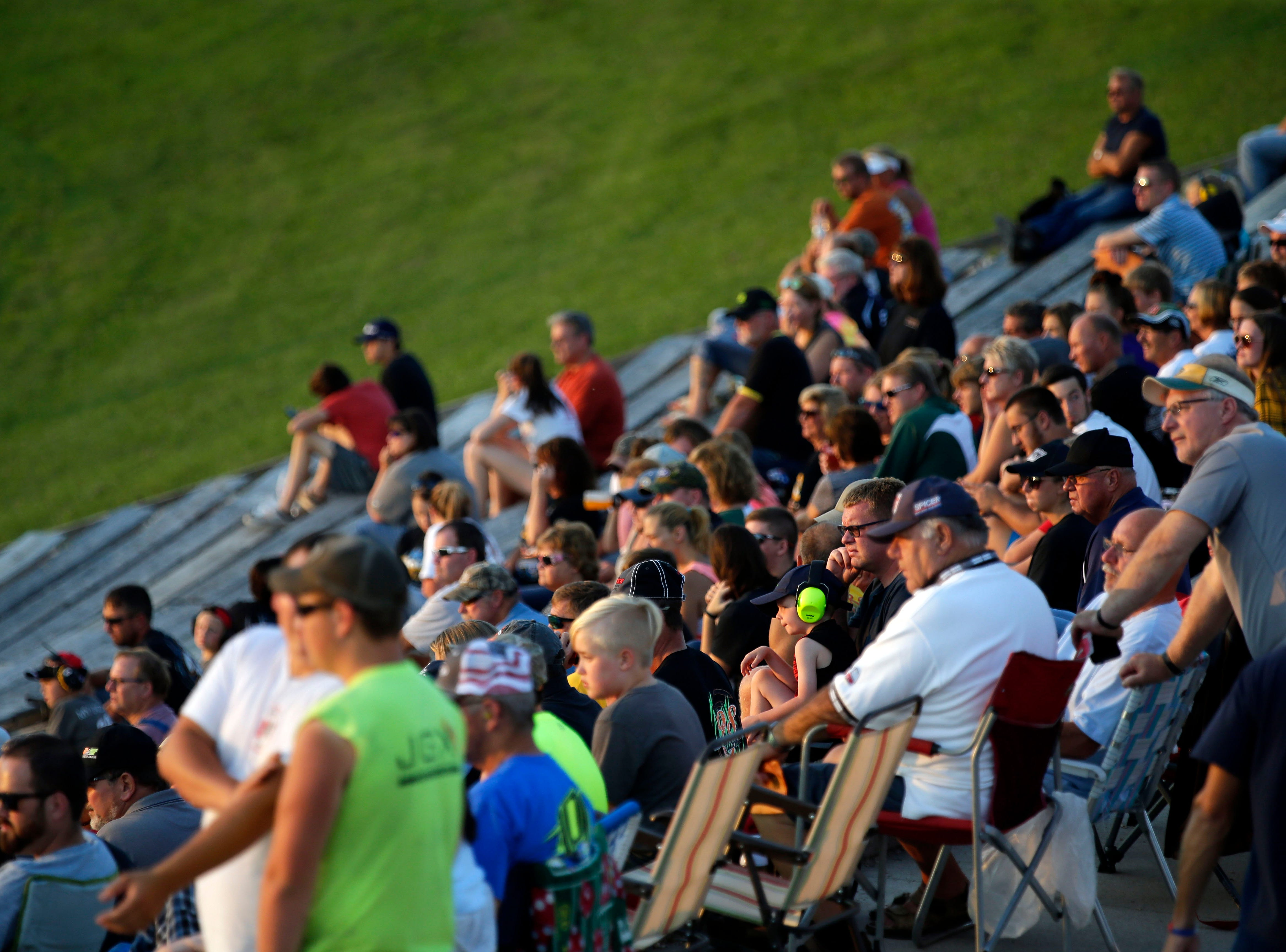 "Fans watch an early race before the Red, White and Blue series concludes with the ""Blue Race"" Thursday, August 9, 2018, at Wisconsin International Raceway in Kaukauna, Wis.