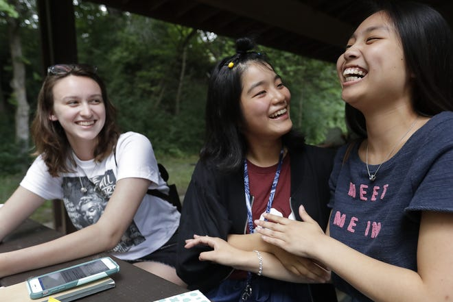 Lexi Frisque, 16, left, of Appleton, Satomi Yokota, 17, of Kanonji, Japan and Tracy Wang, 16, right, of Appleton share a laugh during the Kanonji Appleton Partnership's recent farewell picnic at Peabody Park in Appleton.