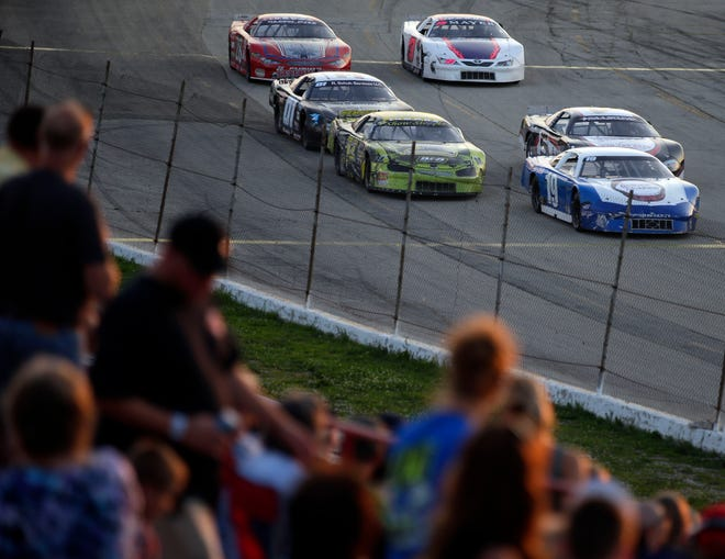 """Fans watch an early race before the Red, White and Blue series concludes with the """"Blue Race"""" Thursday, August 9, 2018, at Wisconsin International Raceway in Kaukauna, Wis.Ron Page/USA TODAY NETWORK-Wisconsin"""