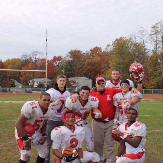 Evan Smutz (second row, right) poses with several Keyport High School football teammates.