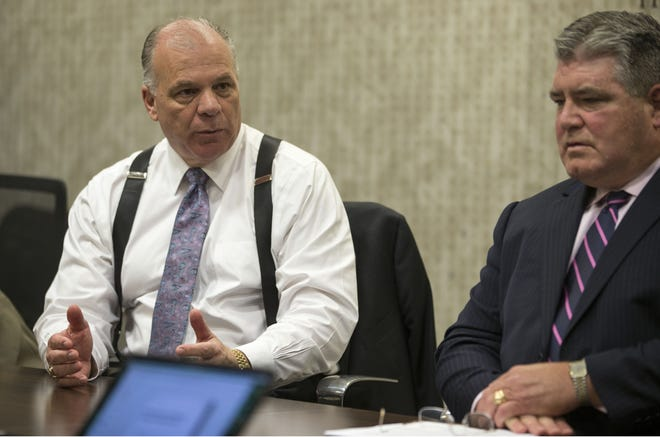 Senate President Steve Sweeney, D-Gloucester, left, and state Sen. Steve Oroho, R-Sussex, discuss the fiscal reform task force report at an editorial board meeting with the Asbury Park Press on Aug. 10,