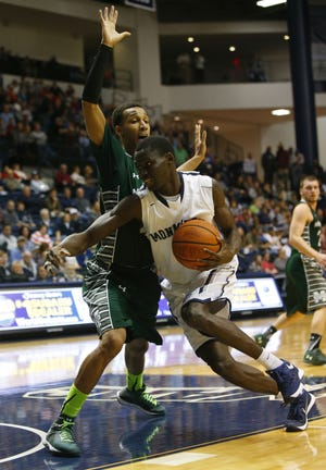 Monmouth forward Pierre Sarr drives to the basket in a 2016 game.
