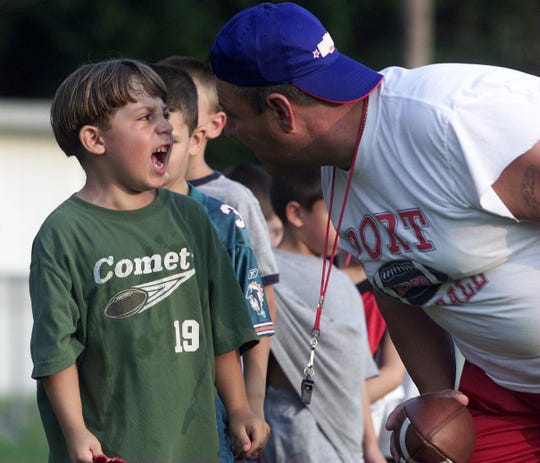 Evan Smutz, 6 of Keyport recites the keys to the game to coach John Merla: Have fun, play hard, win in this 2004 file photo.