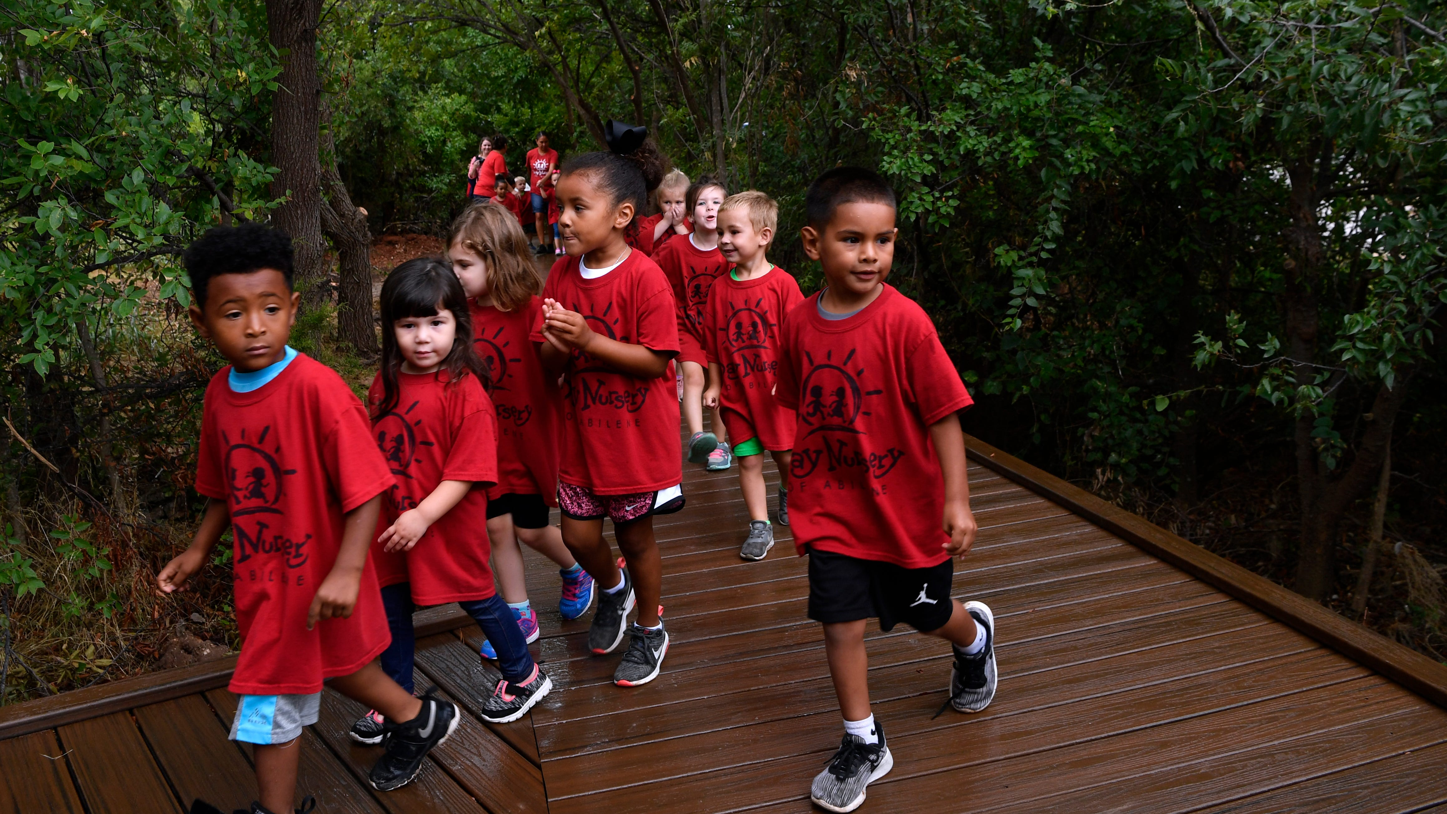Children from Day Nursery of Abilene visit the Kirby Lake Nature Park, which was dedicated Friday August 10, 2018. The park features boardwalks through the trees, a trail to the lake, and an expansion to the already-present playground.