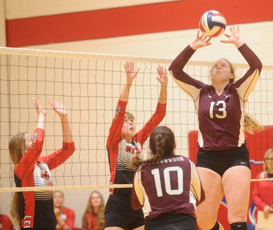 Brownwood's Torrey Miller (13) sets the ball for a teammate against Wichita Falls High. Brownwood won the match 29-27, 25-19 during pool play at the Bev Ball Classic on Friday, Aug. 10, 2018 at Cooper's auxiliary gym.