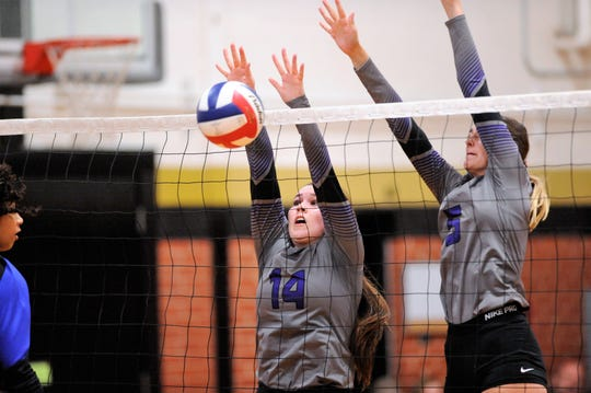 Wylie senior Ginger Lanman (14) goes up for a block with teammate Lilly Kate Doby (5) during a 2-0 win against El Paso Americas at Abilene High on Friday, Aug. 10, 2018. Lanman is the only senior for the Lady Bulldogs this season.
