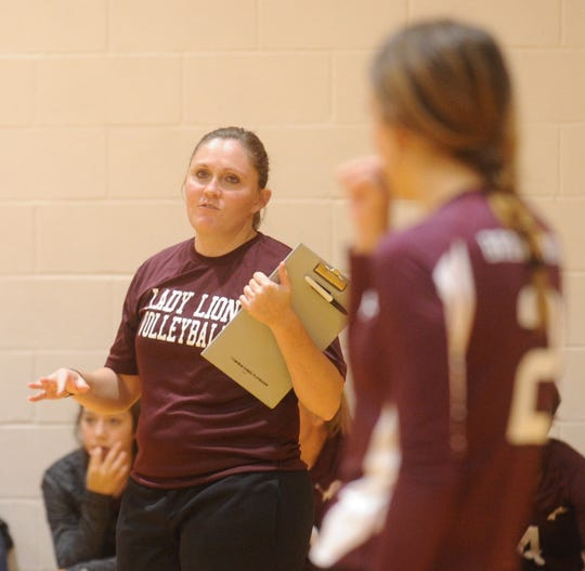 Brownwood coach Jessica Withrow, left, talks to her team during their match with Wichita Falls High. Brownwood won 29-27, 25-19 during pool play at the Bev Ball Classic on Friday, Aug. 10, 2018 at Cooper's auxiliary gym.