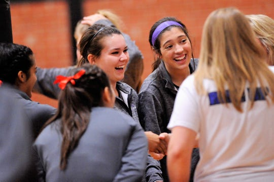 Wylie senior Ginger Lanman, left, laughs with co-captain Keetyn Davis before Friday's match against El Paso Americas in the Bev Ball Classic at Abilene High. The Lady Bulldogs won 2-0.