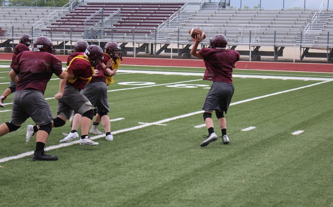 Bronte High School players execute a play action pass during a preseason practice in August.