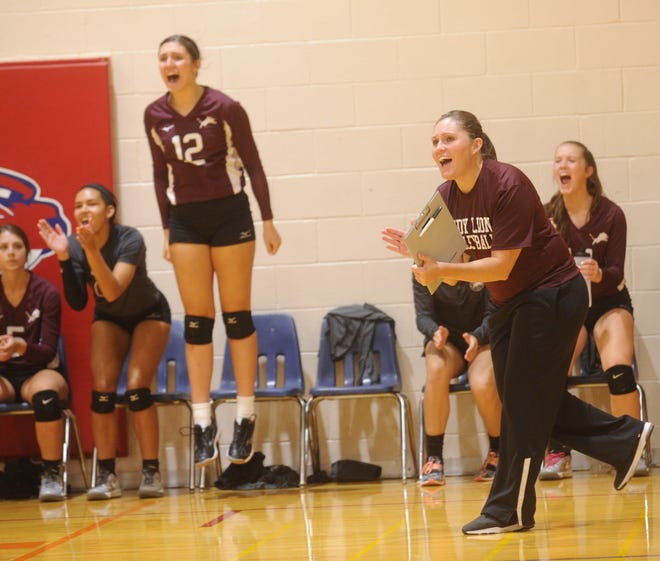 Brownwood coach Jessica Withrow, near right, celebrates a point with her team during their match against Wichita Falls High. Brownwood won 29-27, 25-19 in pool play at the Bev Ball Classic on Friday, Aug. 10, 2018 at Cooper's auxiliary gym.