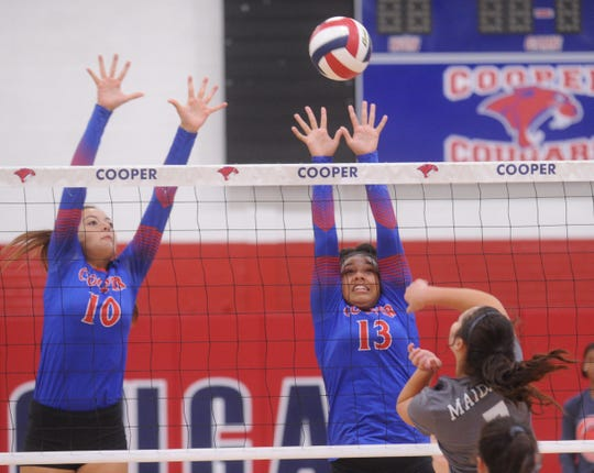 Cooper's Brianna Garcia (10) and Jennika Willis (13) try to block a Seminole player's shot. Cooper won the match 25-22, 25-13 during pool play at the Bev Ball Classic on Friday, Aug. 10, 2018 at Cougar Gym. Cooper went 2-1 in pool play.