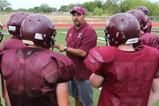 Bronte High School head football coach Jourmain Matta instructs his players during a preseason practice in August 2018.