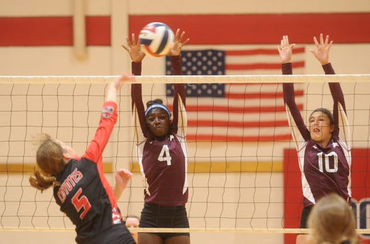 Brownwood's Aleyia Cotton (4) and Katelyn Windam (10) try to block a shot from Wichita Falls High's Paige Coburn. Brownwood won the match 29-27, 25-19 during pool play at the Bev Ball Classic on Friday, Aug. 10, 2018 at Cooper's auxiliary gym.