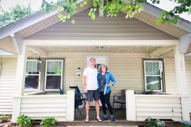 Jonathan Shane Coss and his partner Amy Trujillo in their home on Michigan Avenue in West Asheville which they purchased in December.
