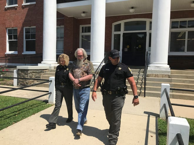 Madison County Sheriff's deputies escort Loyd Wills in handcuffs from the Madison County Courthouse. Wills will serve 20 years with the North Carolina Department of Corrections after pleading guilty to two counts of sexual offense.